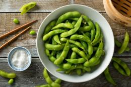 An image of raw, green Edamame Soy Beans.