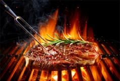 An image of a well-done cooked piece of red meat.