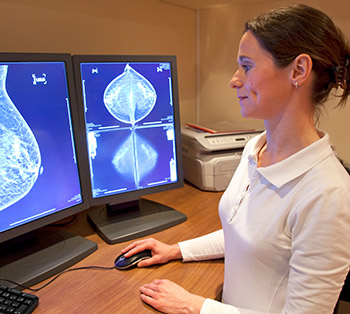 An image of a researcher viewing a digital mammography for breast cancer screening.