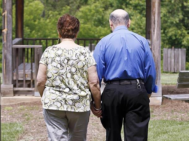 Image of a couple walking outdoors.