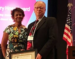 NCORP Director Worta McCaskill-Stevens, MD presents the 2017 Harry Hynes Award to Patrick J. Flynn, MD, of the Metro-Minnesota NCORP.