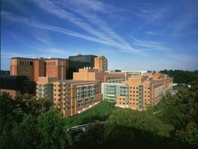 An aerial photograph of the NIH main campus in Bethesda, MD.