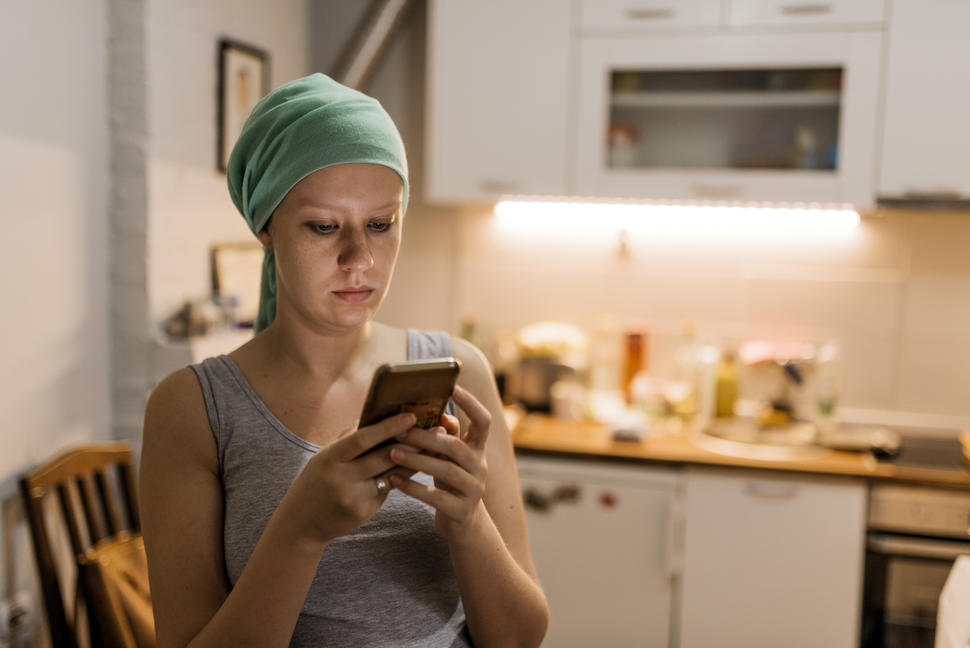 A young adult using a smartphone.