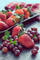 Image of strawberries and blueberries.