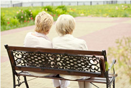 Image of two women sitting on a bench.