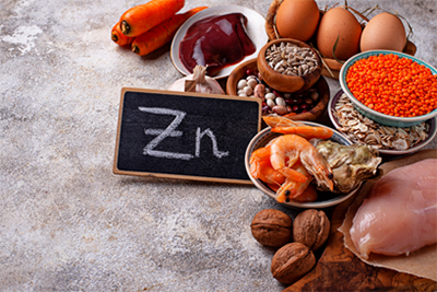 An image of different foods that are high in Zinc.