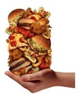 Image of a stack of hamburgers, french fries, and pizza held in one hand.