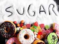 An image of mix of sweet cakes, donuts and candy with sugar.