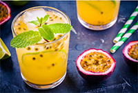 An image of passion fruit and a glass of passion fruit juice.